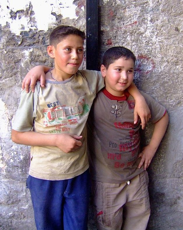 Two boys in Aleppo--friends or brothers--enjoying a peaceful moment together