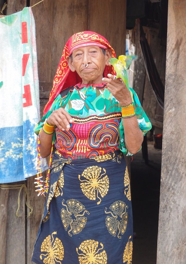 Kuna Woman in Traditional Clothing Holding Bird (San Blas, Panama)